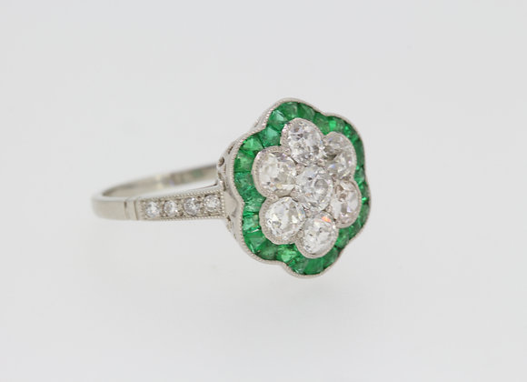 Platinum emerald and diamond cluster ring.