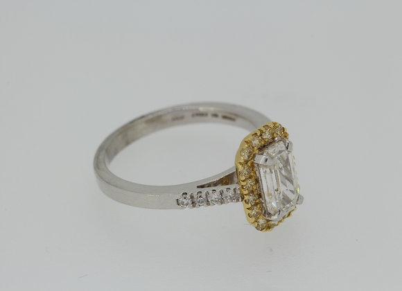 Emerald cut and yellow diamond ring.