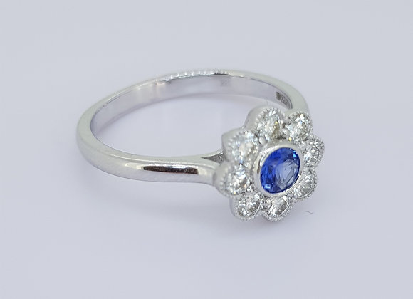 Sapphire and diamond daisy cluster ring s0.20cts d0.45cts