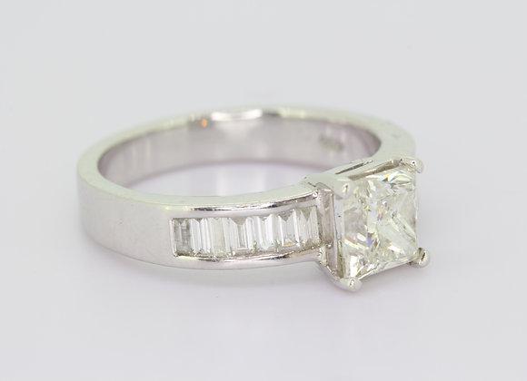 Princess cut diamond with baguette diamond shoulders.