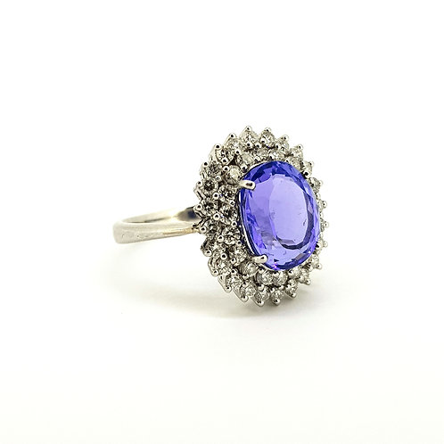 Tanzanite and diamond cluster ring TZ5.60cts D1.26cts