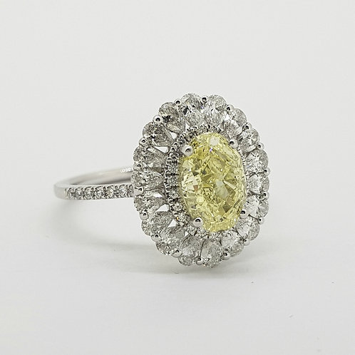 Fancy Yellow Oval diamond cluster ring with GIA cert