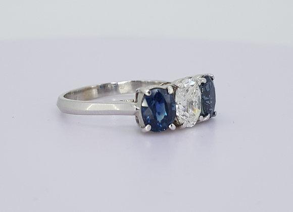 Three stone sapphire and diamond ring.