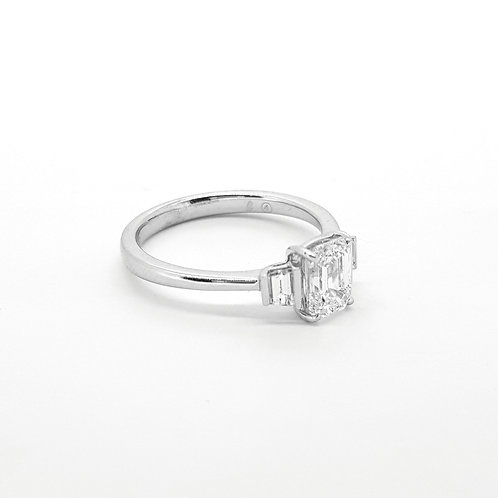 Emerald cut and baguette 18ct diamond ring Centre 1ct