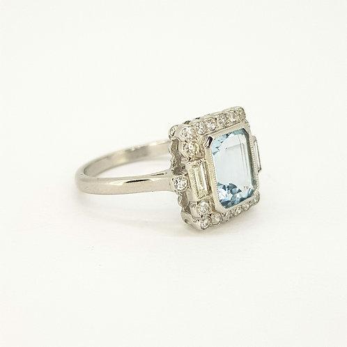 Aquamarine and diamond cluster ring size M