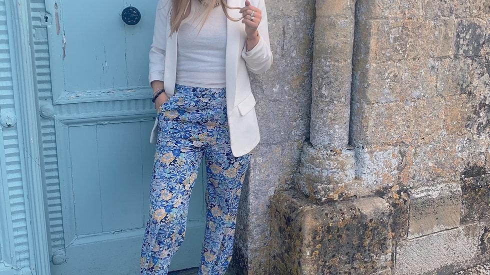 Pantalon fleuri jaune et bleu