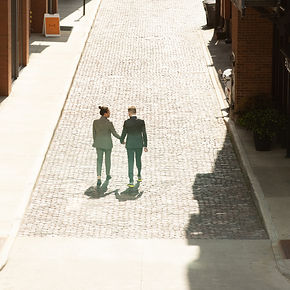 Two Grooms Walkin on an Empty Street