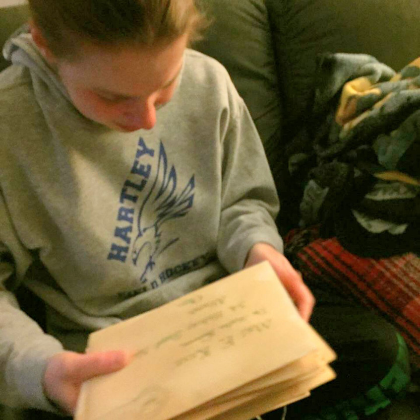Eryn receives 17 years of Hogwarts acceptance letters, personalized to her address.