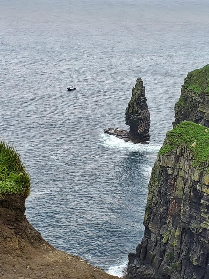 For perspective, look at the boat against the cliffs.