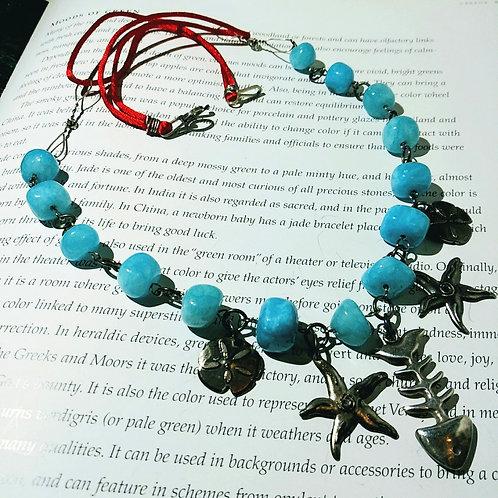 Necklace, fish skull