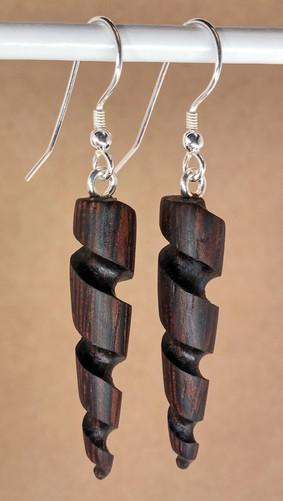 Small dark spiral wood earrings.jpg