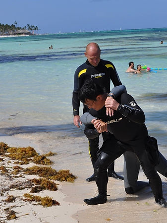 Rescue Divers Exiting Onto Beach