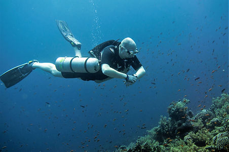 Sidemount Diver Gliding Over Coral Reef