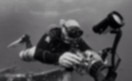Diver Taking Underwater Digital Photographs With DSLR