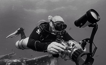 Diver Taking Underwater Digital Photographs With DSLR