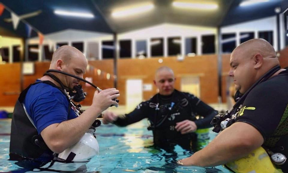 Sidemount Divers Kitted Up In The Swimming