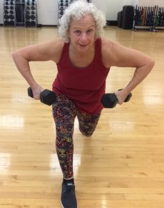 Body positive senior citizen getting fit with weights