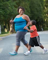 Mother and son exercising outside