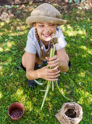 kid-holding-plant-700px.jpg