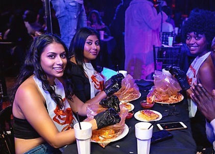girls eating seafood boil at brunch event in london