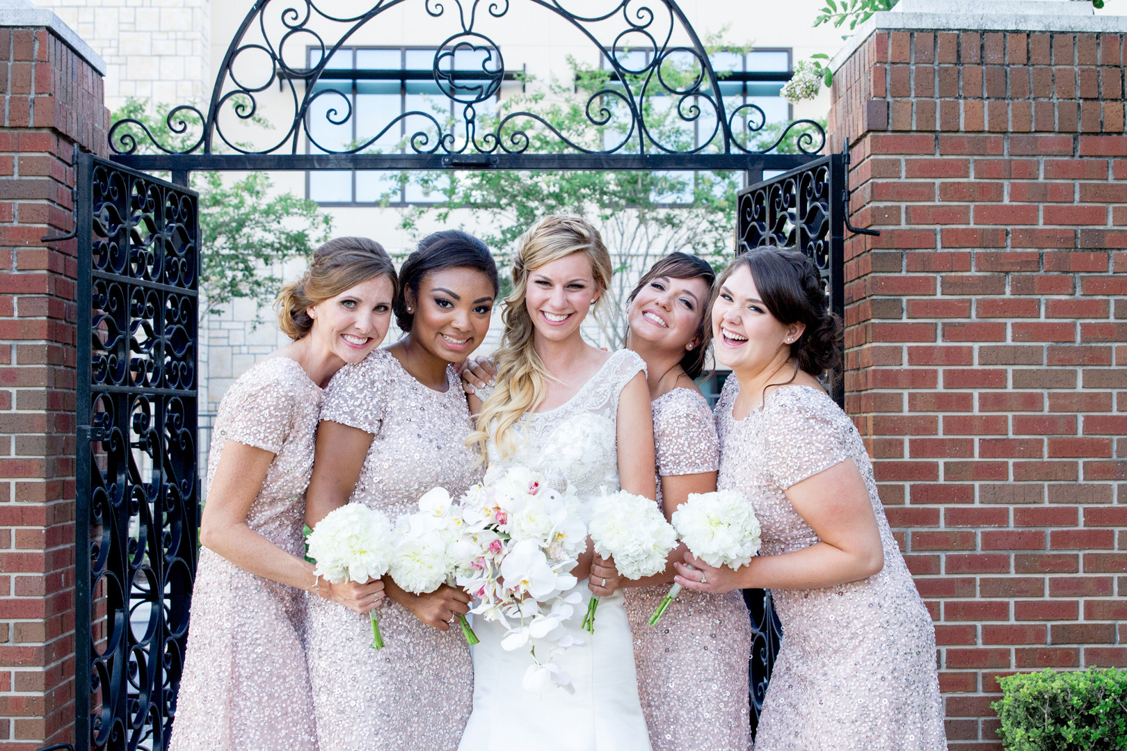blush pink sequin bridesmaids with bride smiling