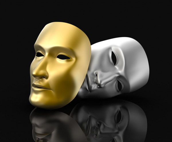 Two masks, the universal representation of drama. One gold, one silver, against a black background