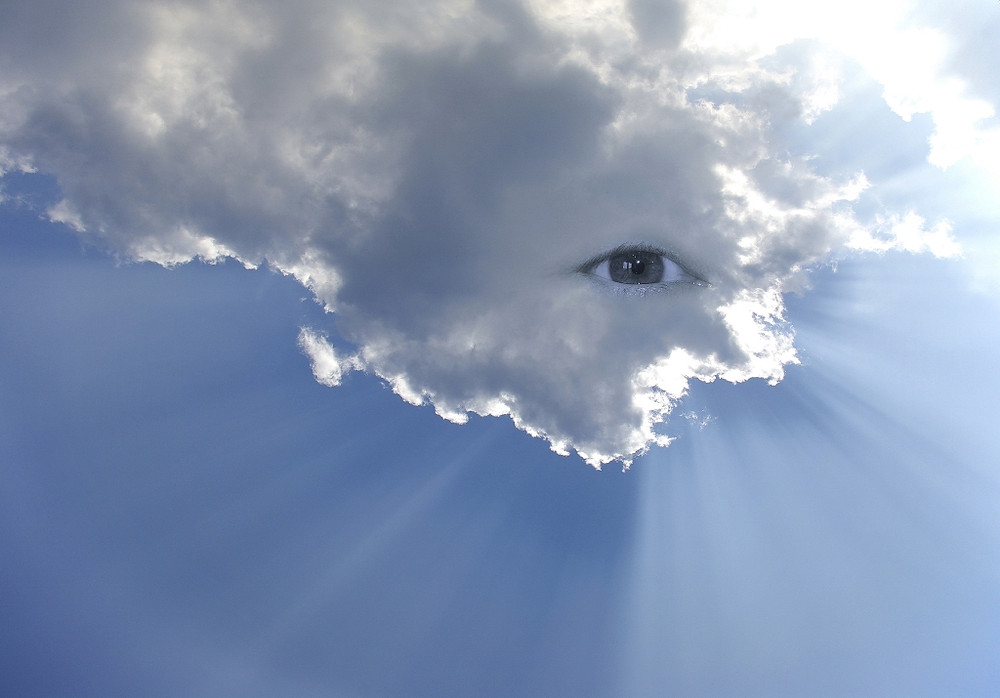 Surreal eye-in-a-cloud image depicting all-seeing, all-knowing, Godlike perspective