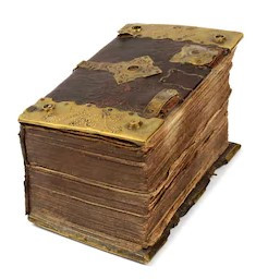 A very ancient and very thick and tattered tomb of a book