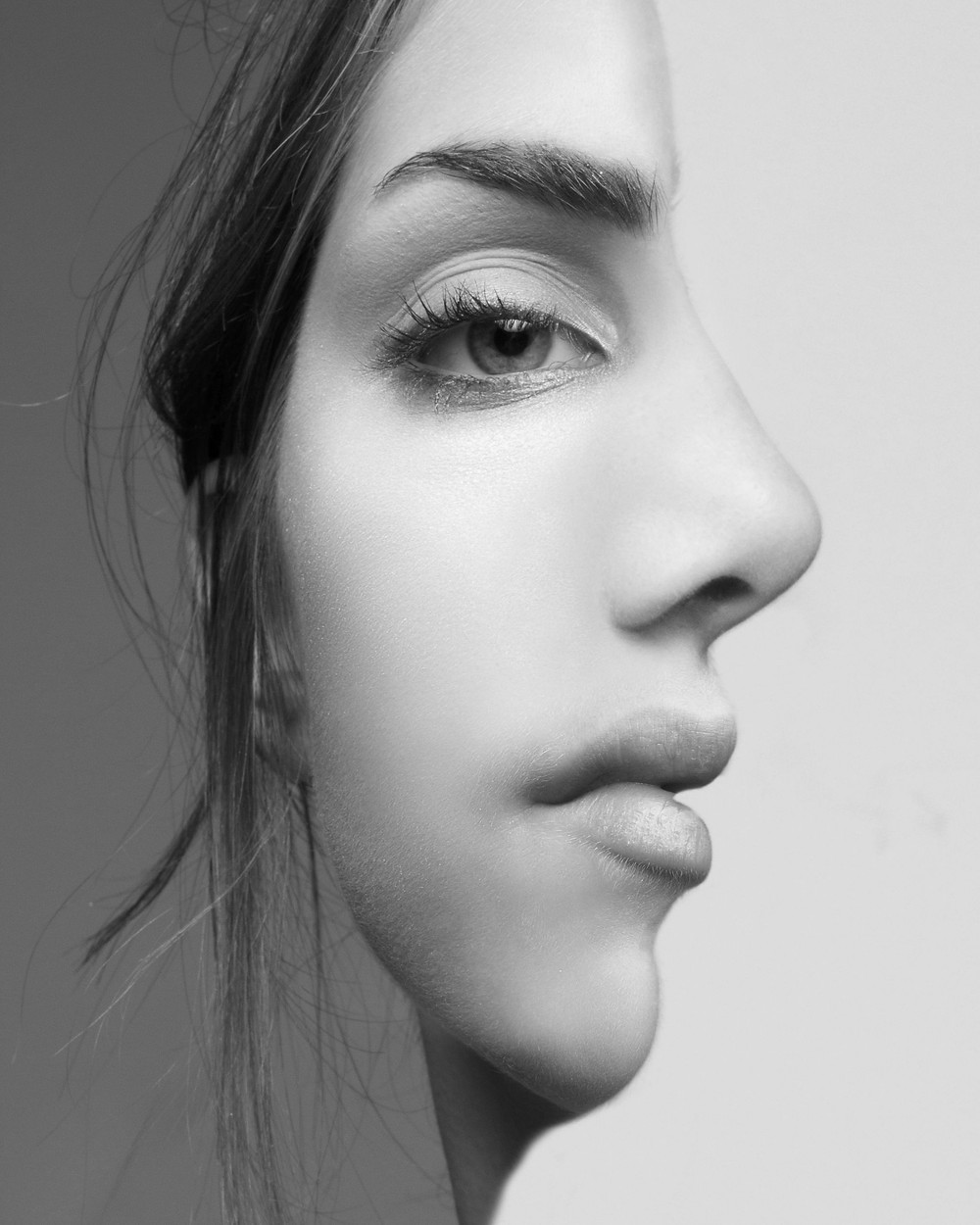 First Person Point of View: side-view/front-view merged female profile illusion