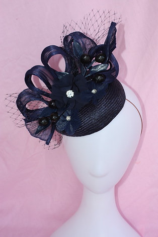 Navy small hat with chiffon floral cluster