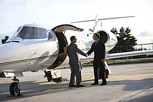 bigstock-Businessmen-shake-hands-by-cor-