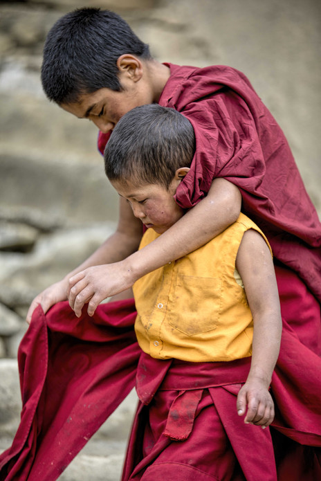 The child monks adorn a three part maroon robe