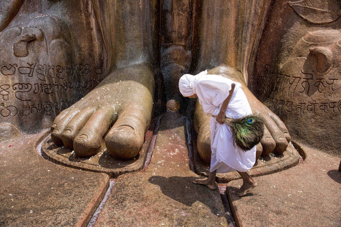 A lady at the feet of Bahubali