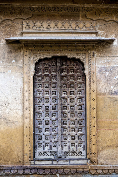 An iron door with spikes and bolts