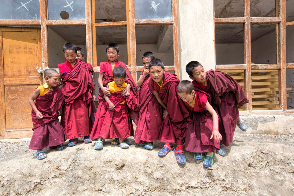 A group of young monks posing