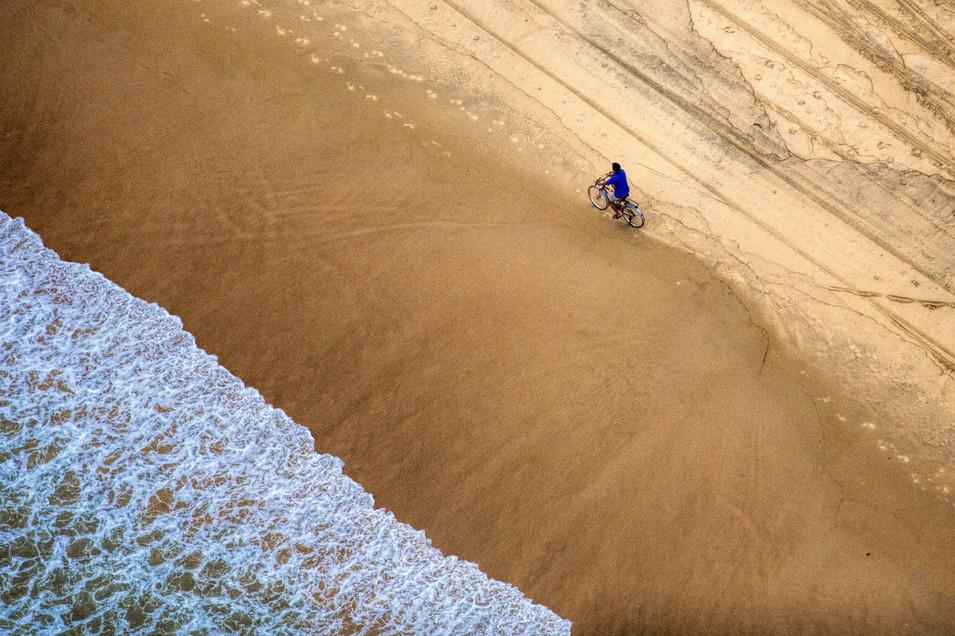 Cycling along the beach, Goa