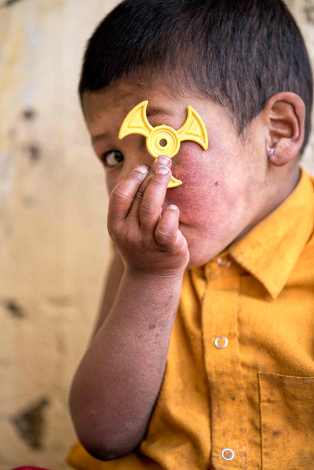 The fidget spinner is a popular toy even with the child monks