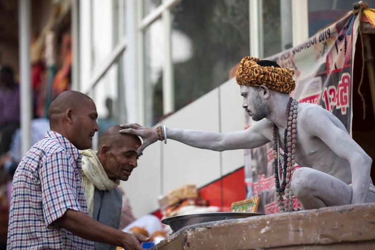 Pilgrims seeking blessings from Naga Sadhu