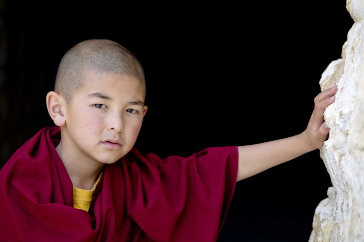 When they first enroll in the monastery their head is shaved and the normal clothing is given up for the three-part maroon robe as a sign of young monks have to shave thier heads and normal clothes are given up for the three part red robe as a sign of commitment to the monastery