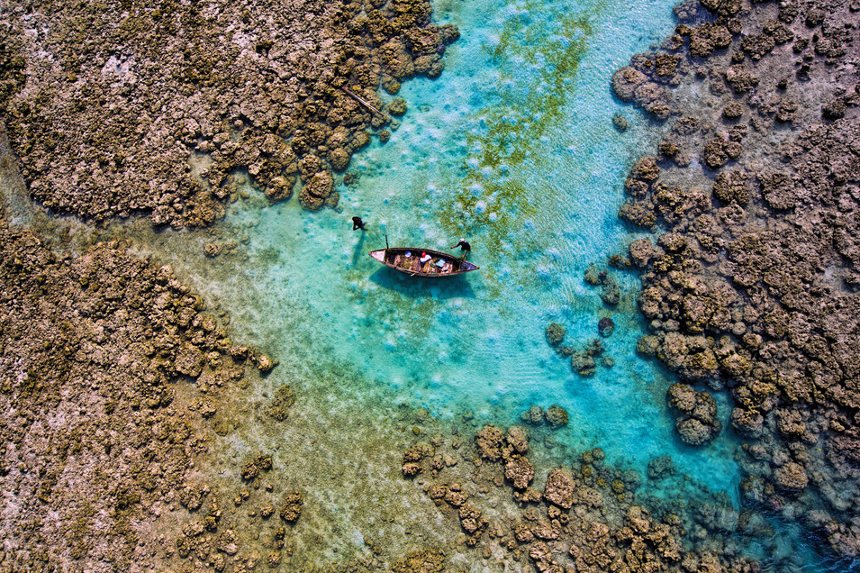 Coral colored boat- Havelock island