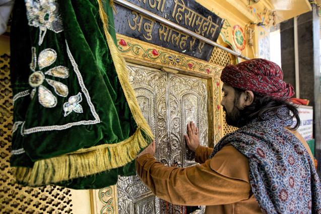The Khadim at the dargah gate