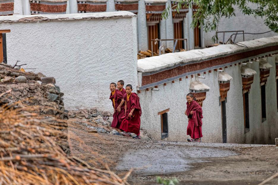 Monks walking out of their school in Hemis monastery