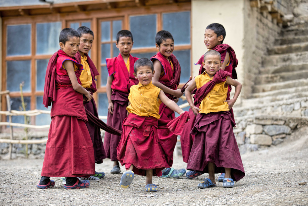 A group of young monks enjoying a game