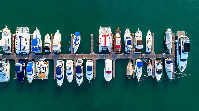 Pier speedboat. A marina lot. This is us