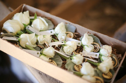box of boutonnieres