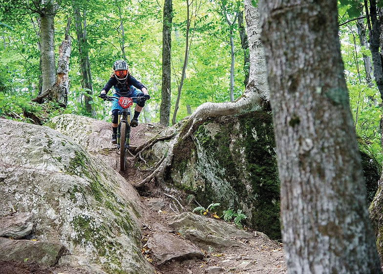 Mountain biking single track and road racing in Stowe Vermont