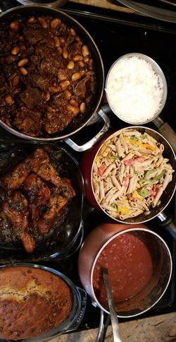 Braised oxtails, oven BBQ chicken, whole wheat rasta pasta, stewed red beans & pigtails, jasmine ric