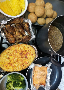 Baked salmon, oven-fried chicken, macaroni pie, stewed lentils, steamed broccoli, whole wheat hops b