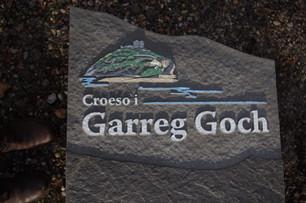 Handpainted slate logo for holiday park.