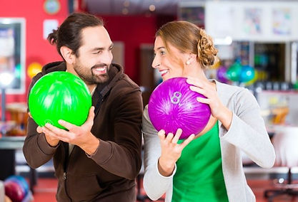 One couple enjoying bowling on a date night.